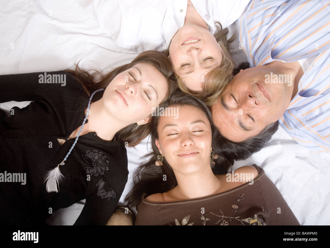 family without worries - sleeping - Stock Image