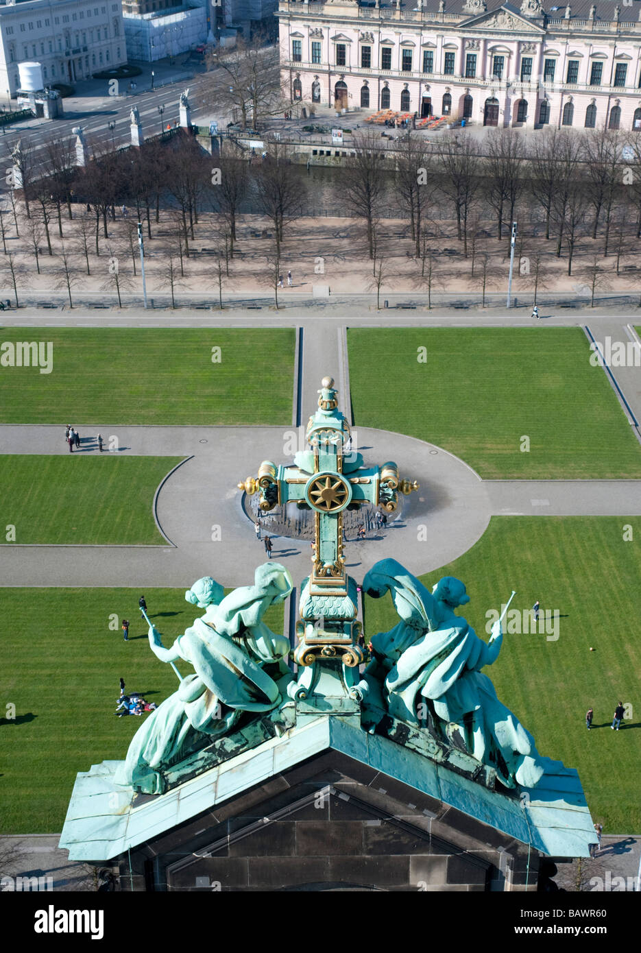 View of the Lustgarten square from Berlin Cathedral with religious statue decoration in foreground - Stock Image