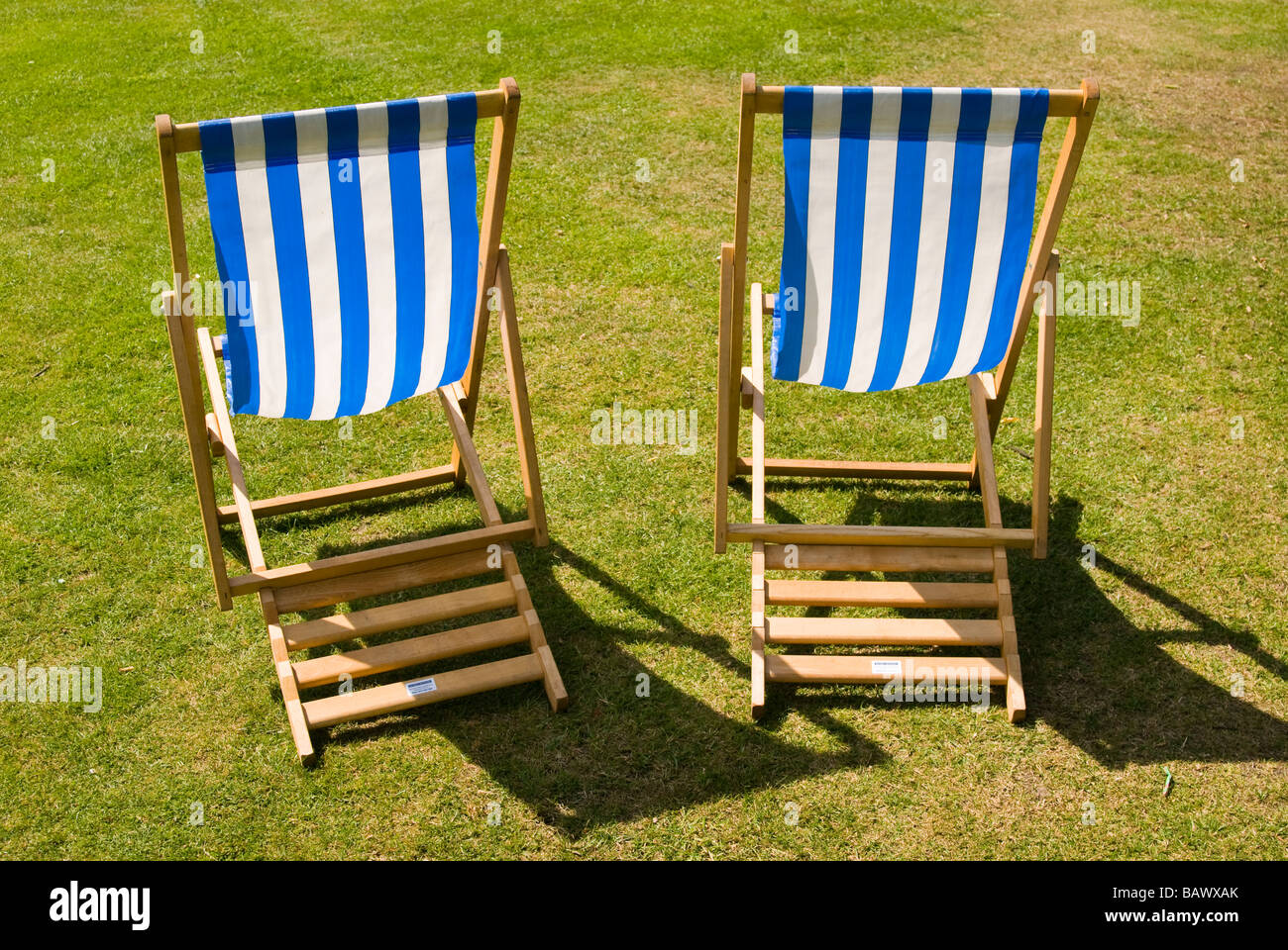 Deckchairs on a lawn - Stock Image