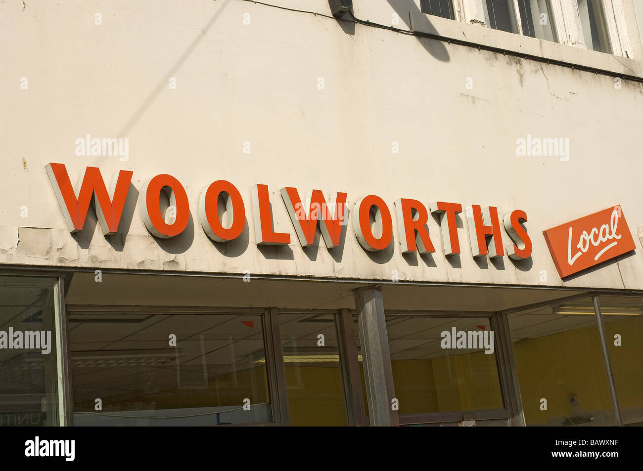 Signage of redundant Woolworths shop store England UK United Kingdom GB Great Britain - Stock Image