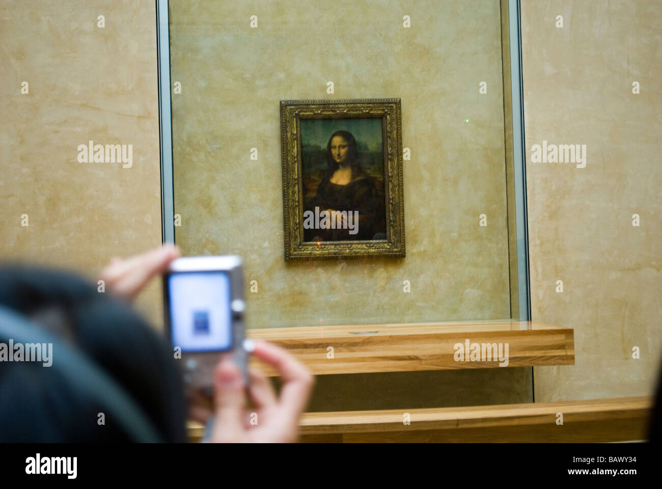 Woman Photographing Mona Lisa in Musee du Louvre - Stock Image