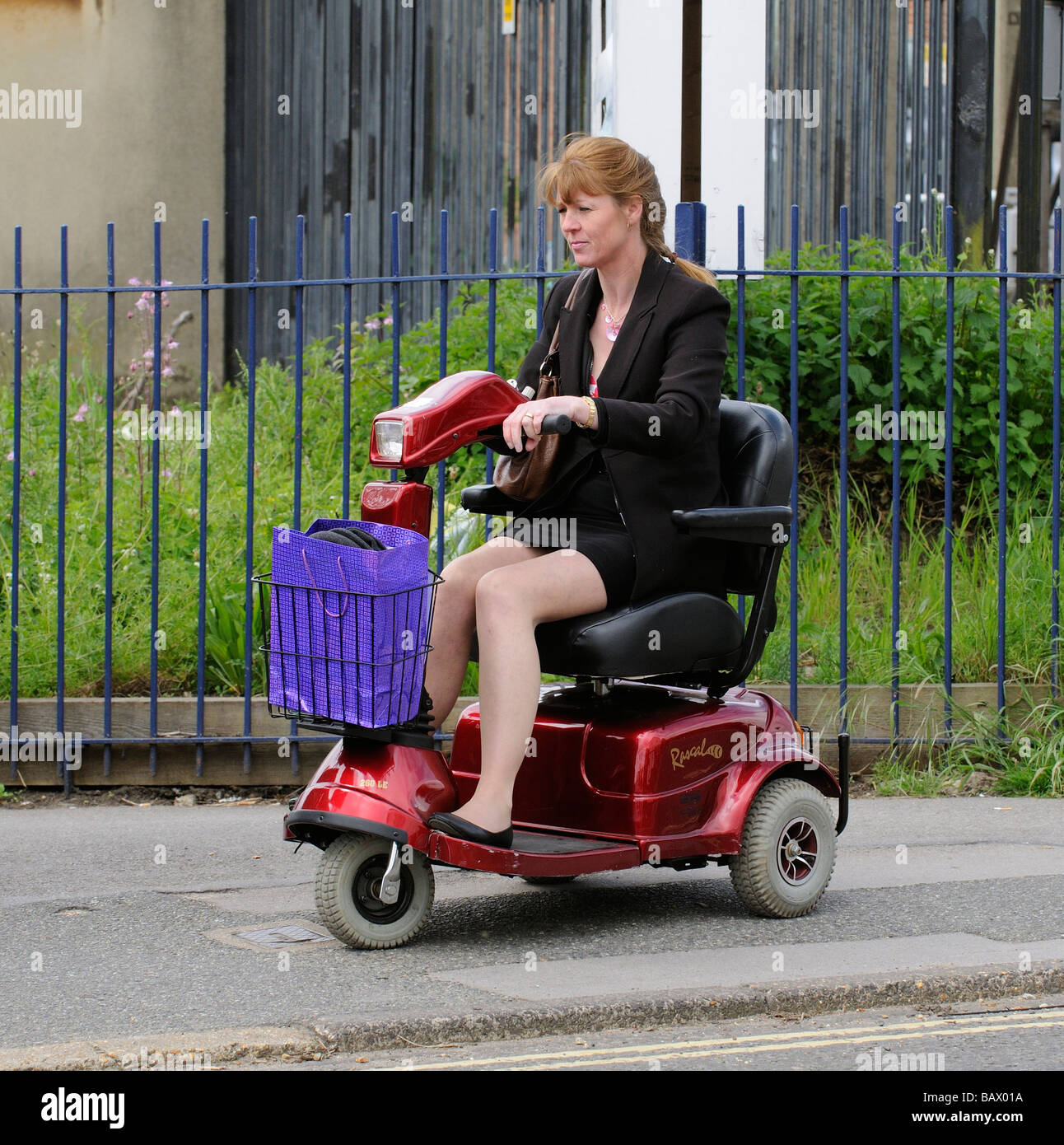 Woman seated on a Rascal mobility scooter driving along the pavement - Stock Image  sc 1 st  Alamy & Rascal Scooter Stock Photos u0026 Rascal Scooter Stock Images - Alamy