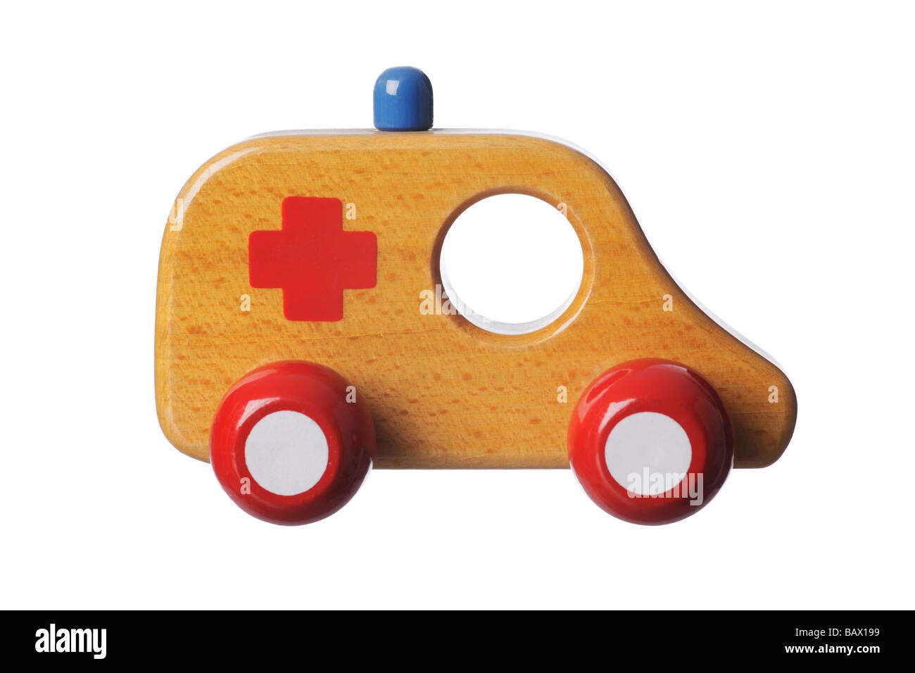 Wooden toy ambulance - Stock Image