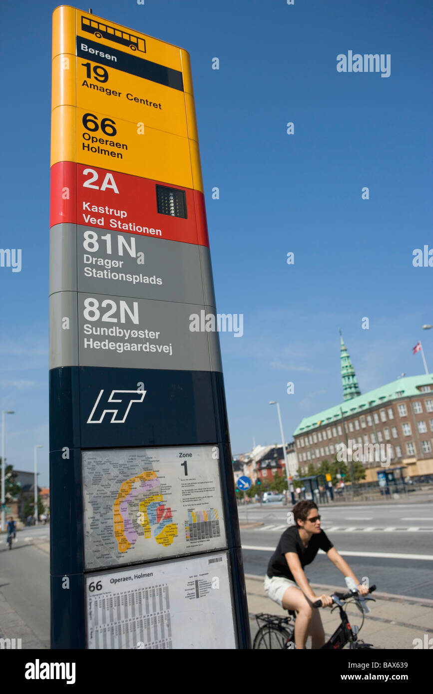 Copenhagen, Denmark; Bus stop with cyclist riding by - Stock Image