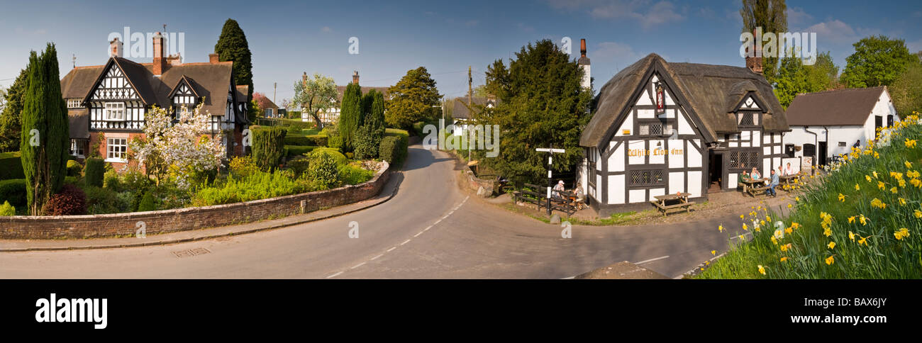 Panoramic View of the White Lion Inn and Village of Barthomley in Spring, Cheshire, England, UK - Stock Image