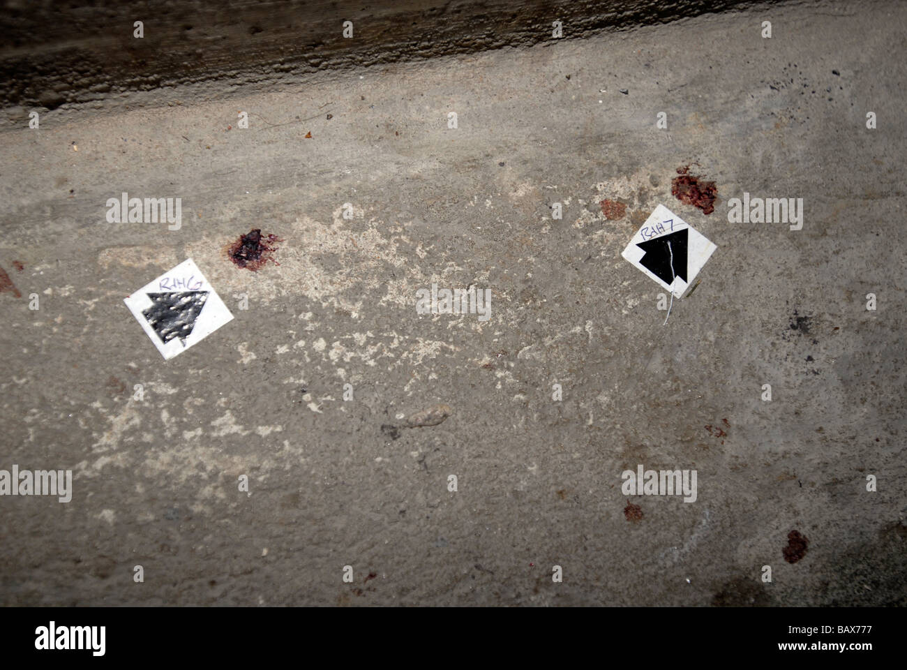 Blood spots marked by a black arrow in a crime scene - Stock Image