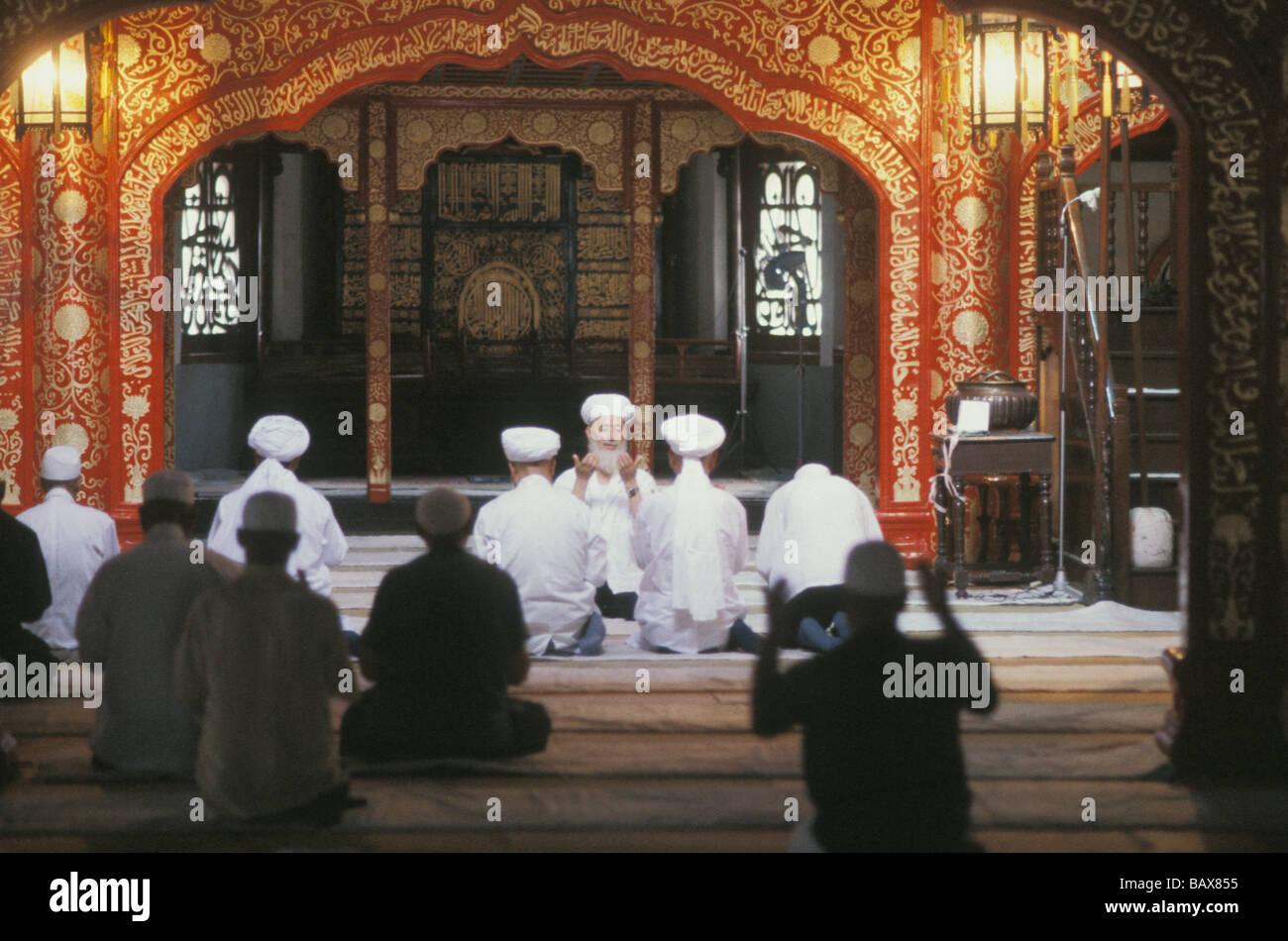 Hui Muslims worship at noon prayers in Niu Jie mosque in Beijing China - Stock Image
