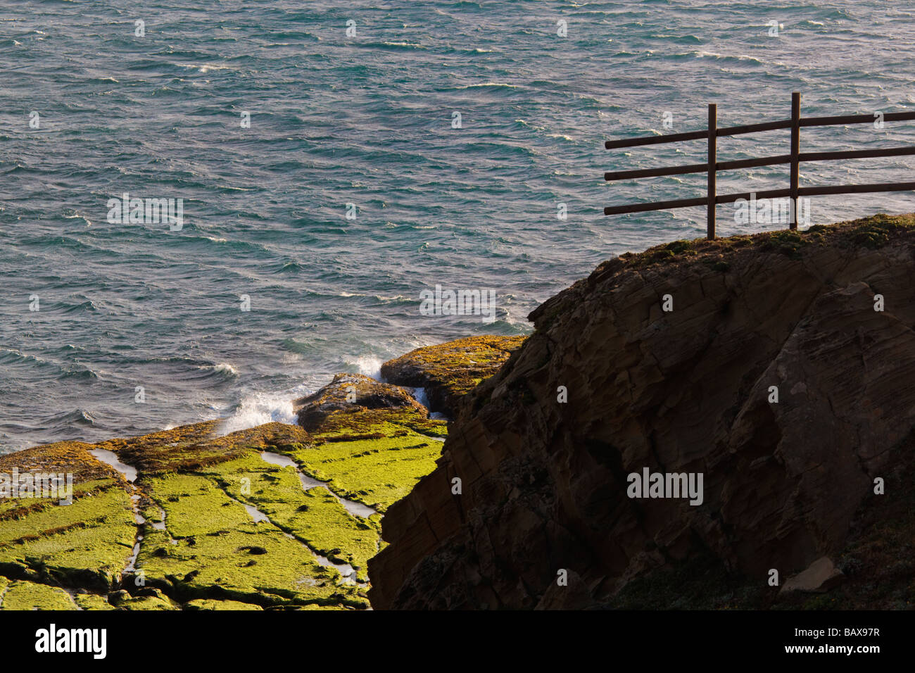 Fence leading off cliff to nowhere - Stock Image