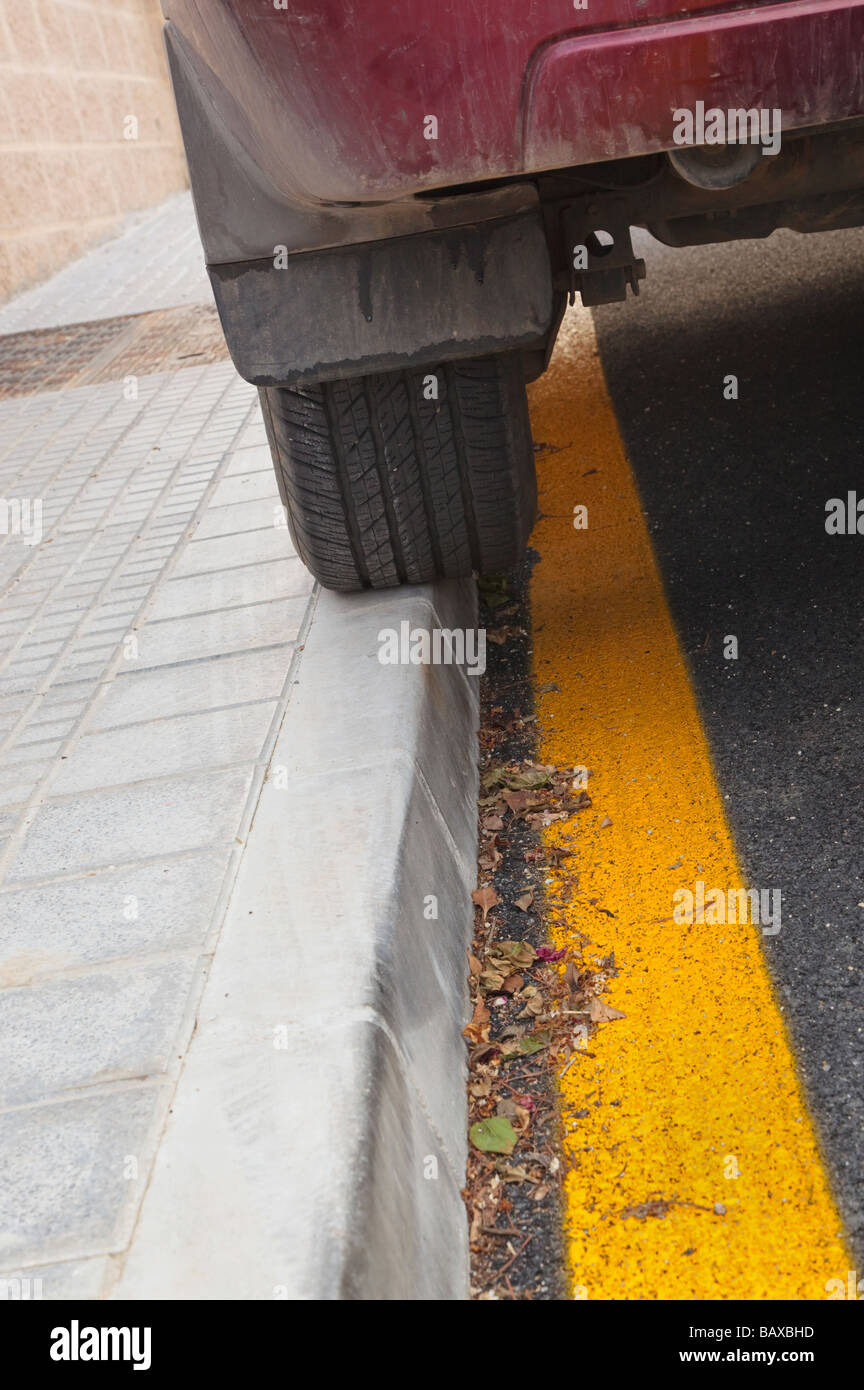 Vehicle breaking two by laws Parked on footpath and on yellow line - Stock Image