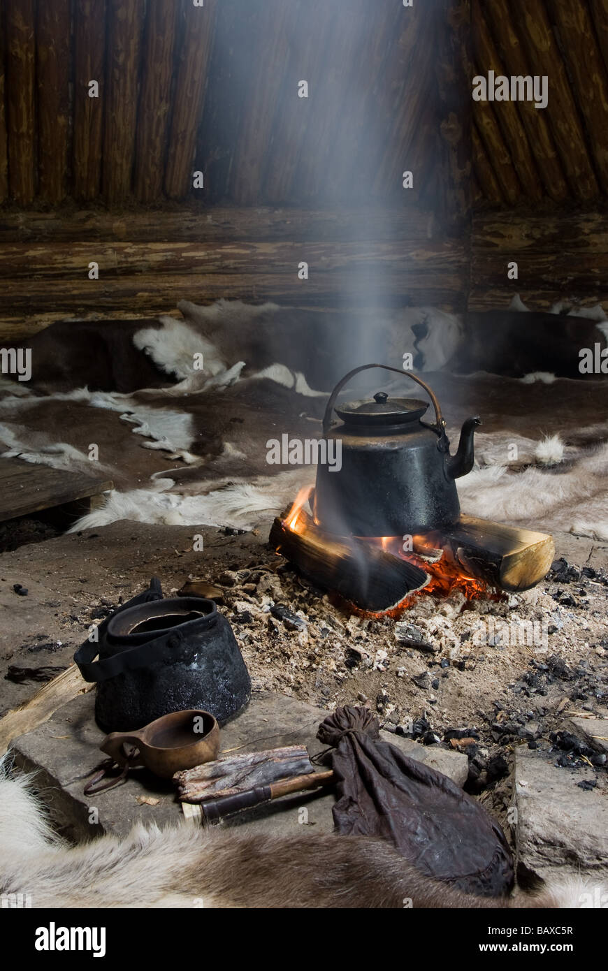 Traditonal way of making Sami coffee with reindeer meat, in a Gåhtie (traditional Sami house) in Båtsuoj - Stock Image