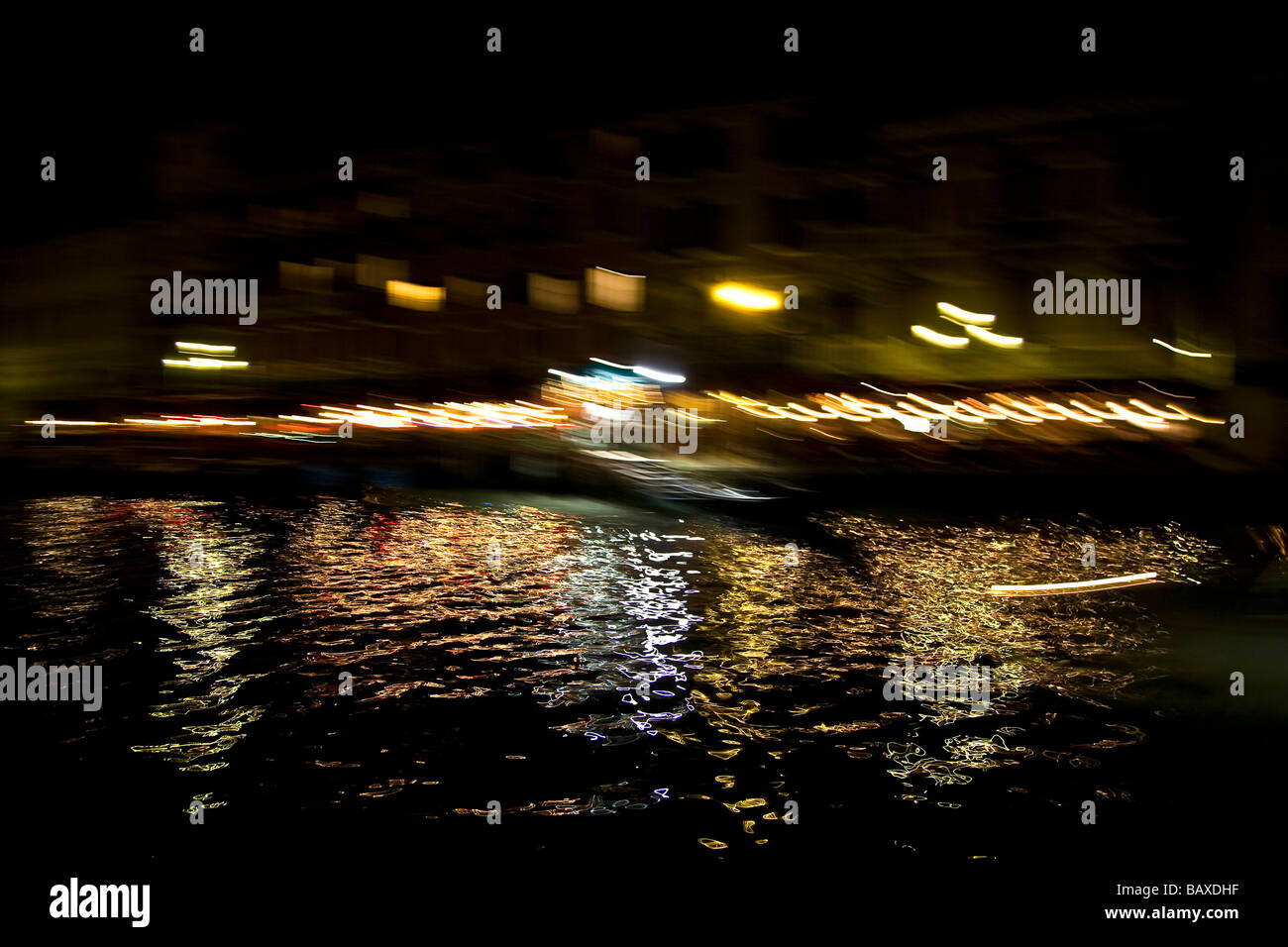 Water at night reflected light - Stock Image