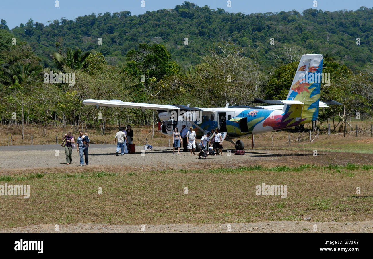 Small 'Nature Air' propeller plane on runway, Drake Bay, Costa Rica - Stock Image
