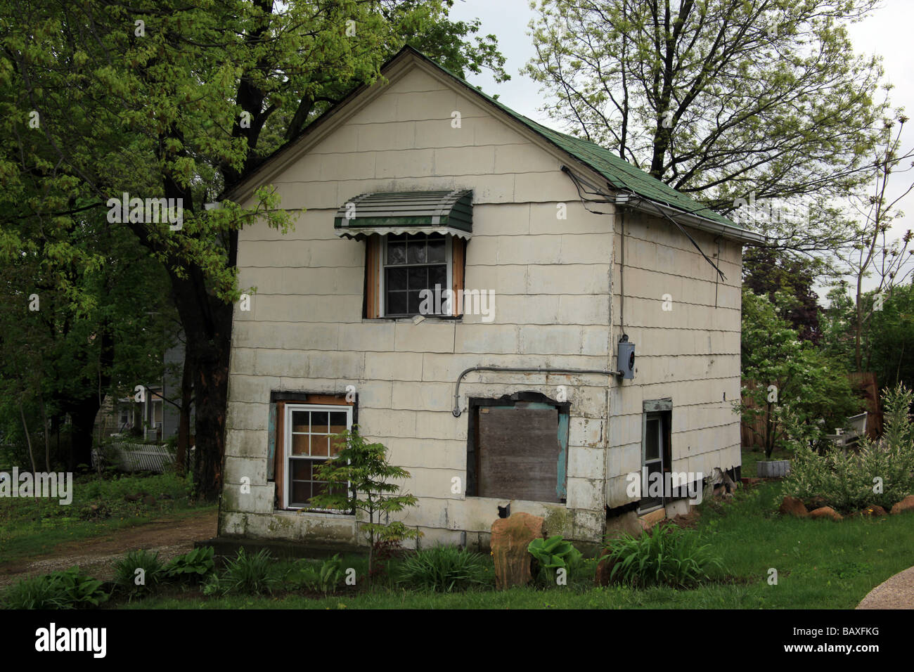 Dilapidated house in serious state of disrepair. - Stock Image