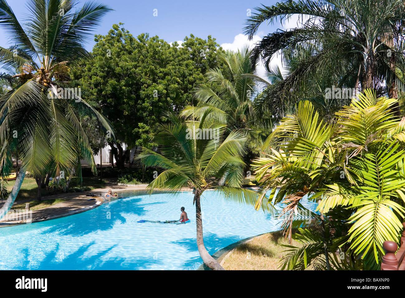 Guests bathing in the swimming pool, Sarova Whitesands Beach Resort and Spa, Shanzu Beach, Coast, Kenya - Stock Image