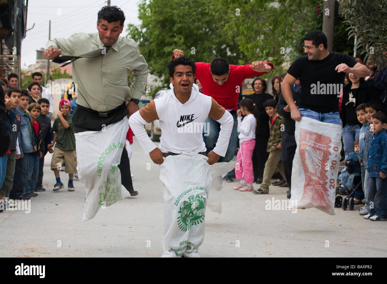 A group of men taking part in a sack race at the Easter games, Kathikas, South Cyprus, Cyprus - Stock Image