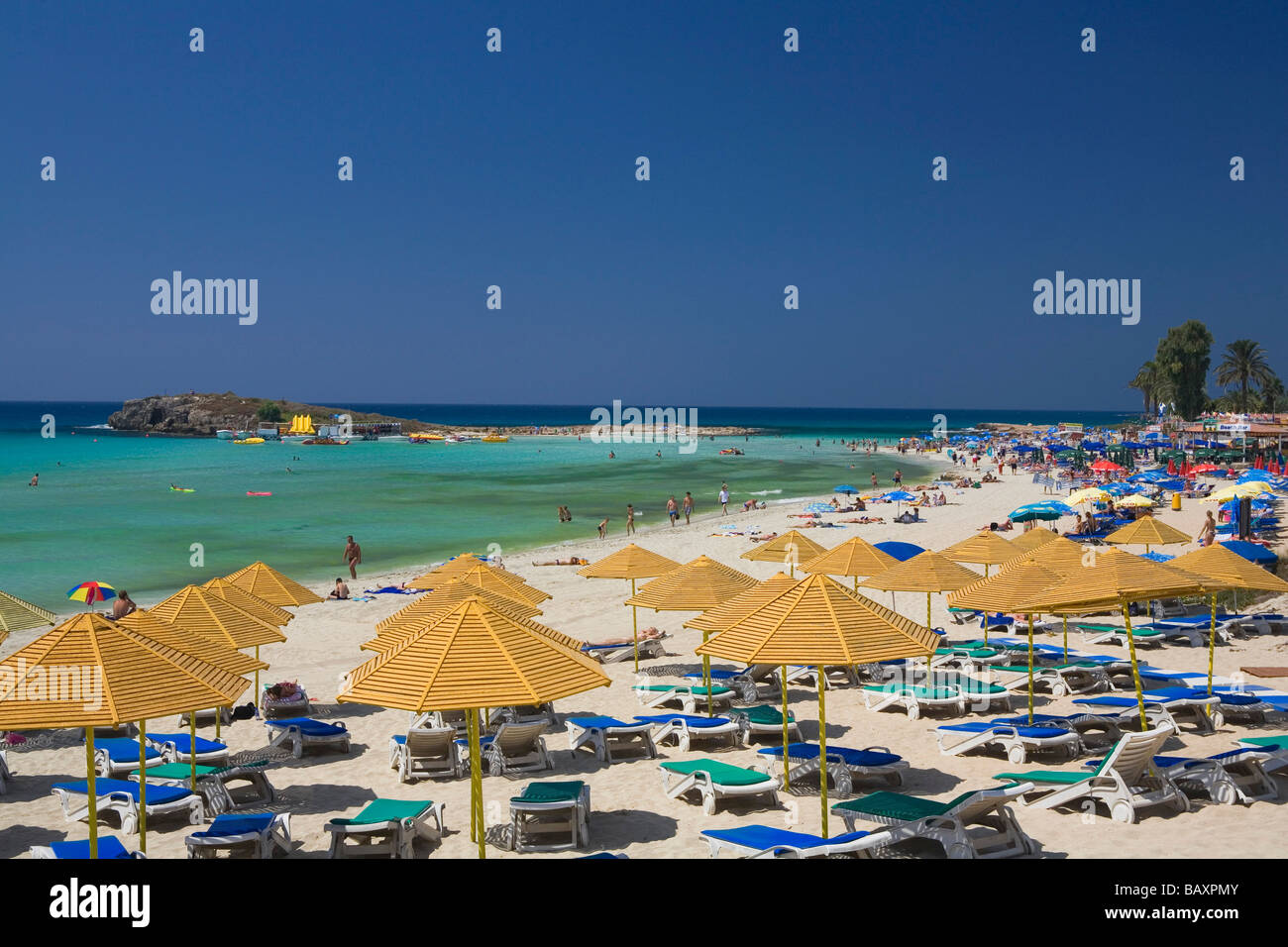 Nissi Beach with sun loungers and sunshades, Agia Napa, South Cyprus, Cyprus - Stock Image
