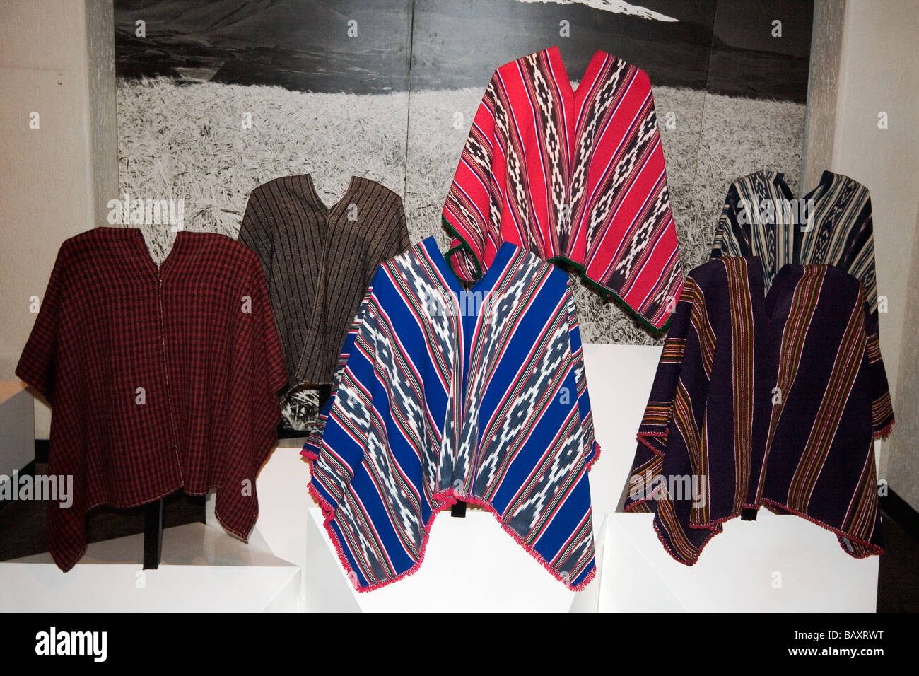 Ponchos of ethnic groups at the Museum of Ethnology in La Mitad del Mundo monument, San Antonio, Pichincha Province, - Stock Image