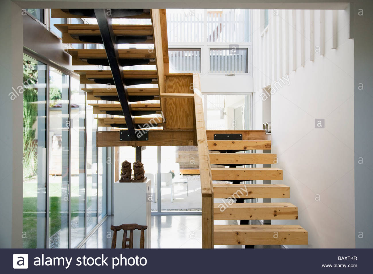 Interior of modern house, wooden stairway - Stock Image