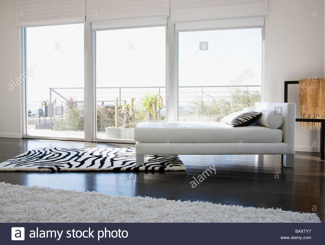 Interior of modern living room with glass walls stock image