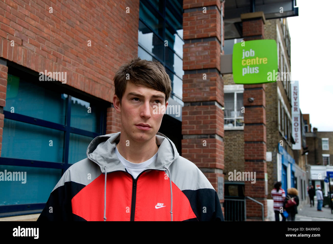 Young 20 year old man looking for work outside job centre plus - Stock Image