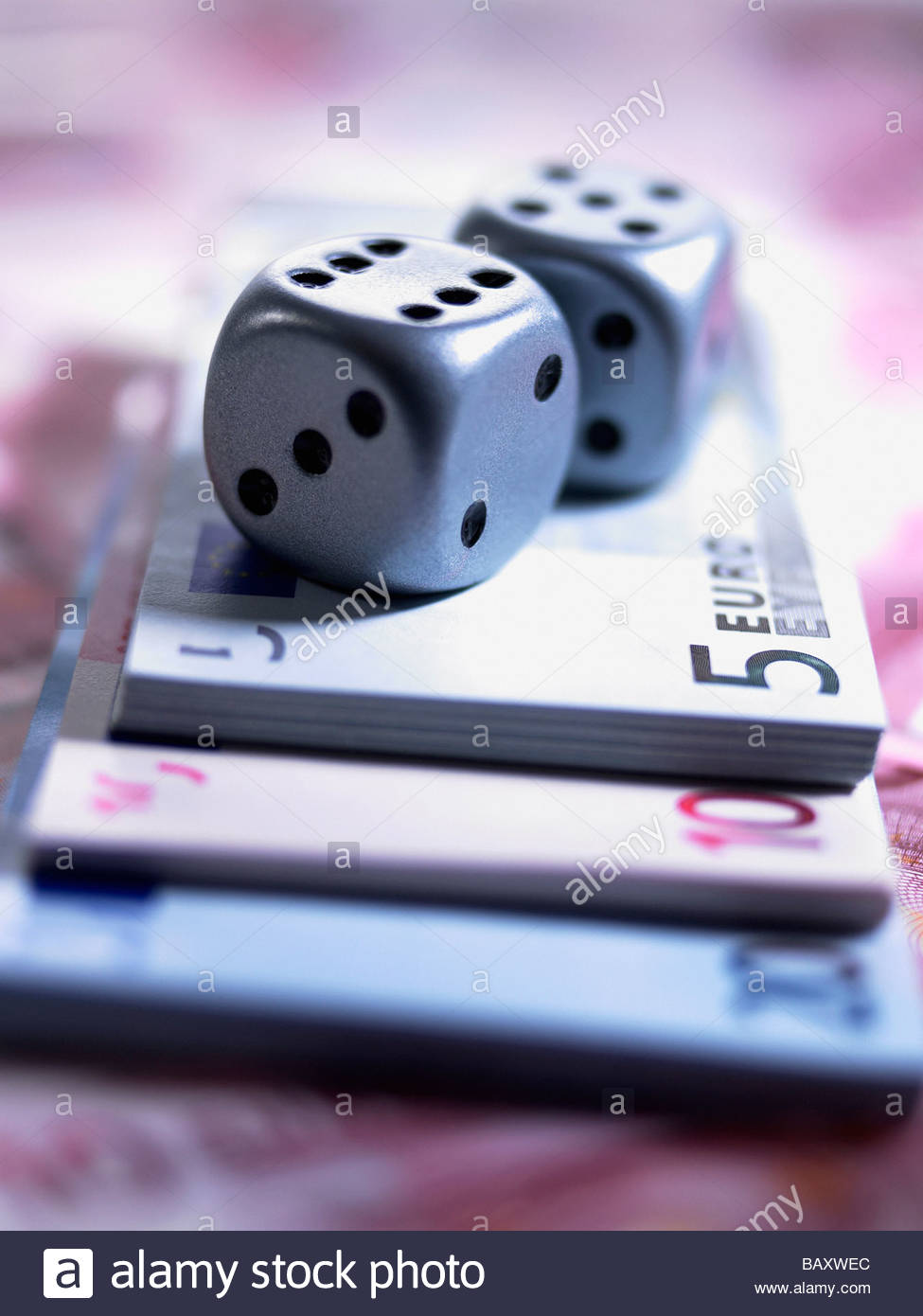 Close up of dice and euro notes - Stock Image