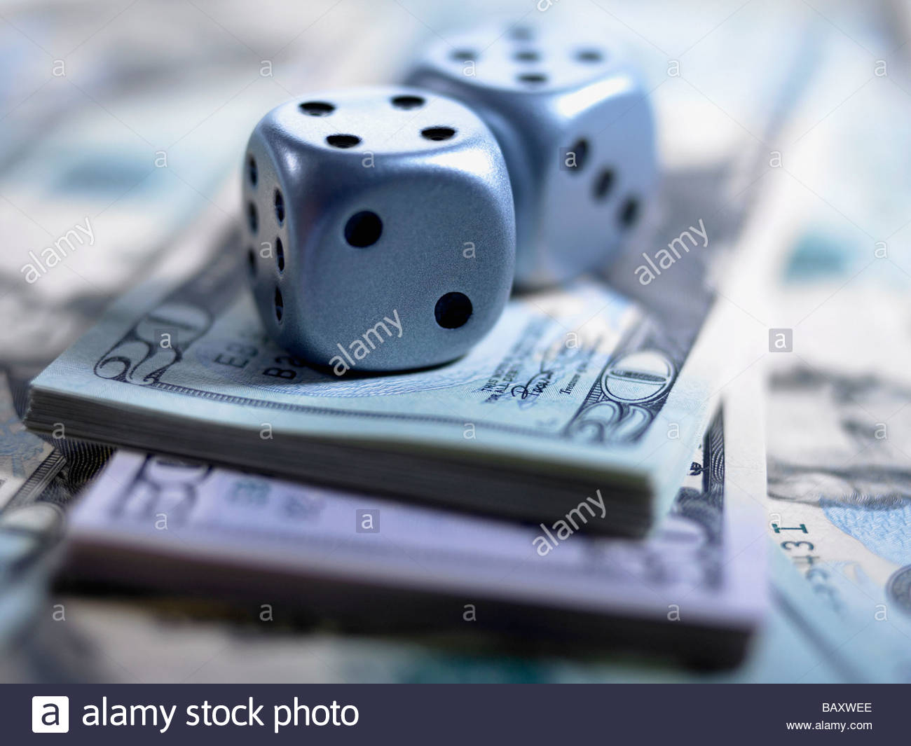 Close up of dice and US currency - Stock Image