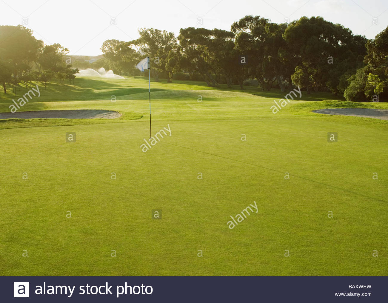 Flag on putting green of golf course - Stock Image