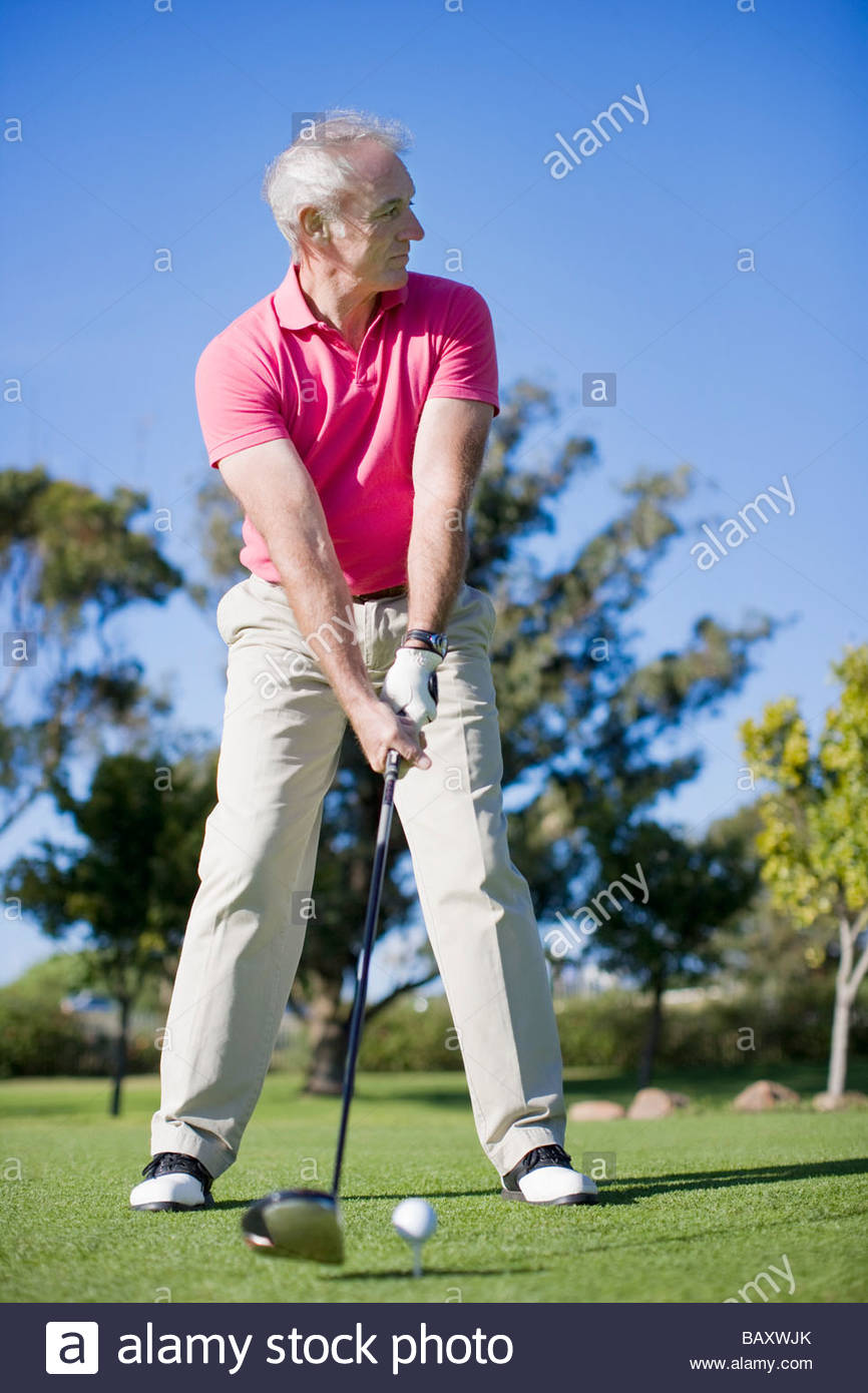 Man playing golf - Stock Image