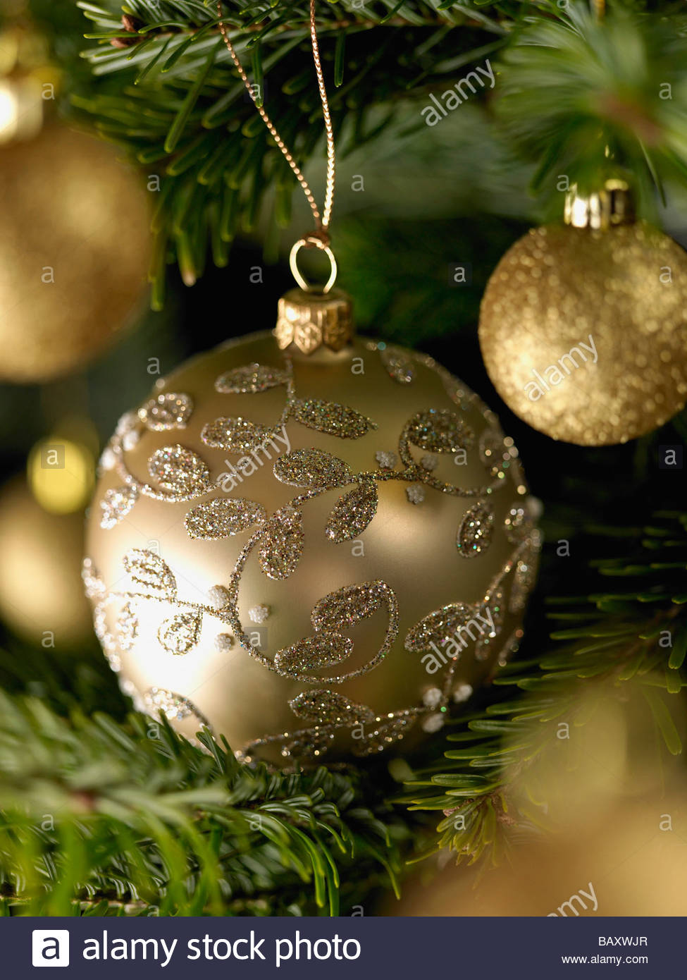 Close Up Of Gold Christmas Ornaments On Tree