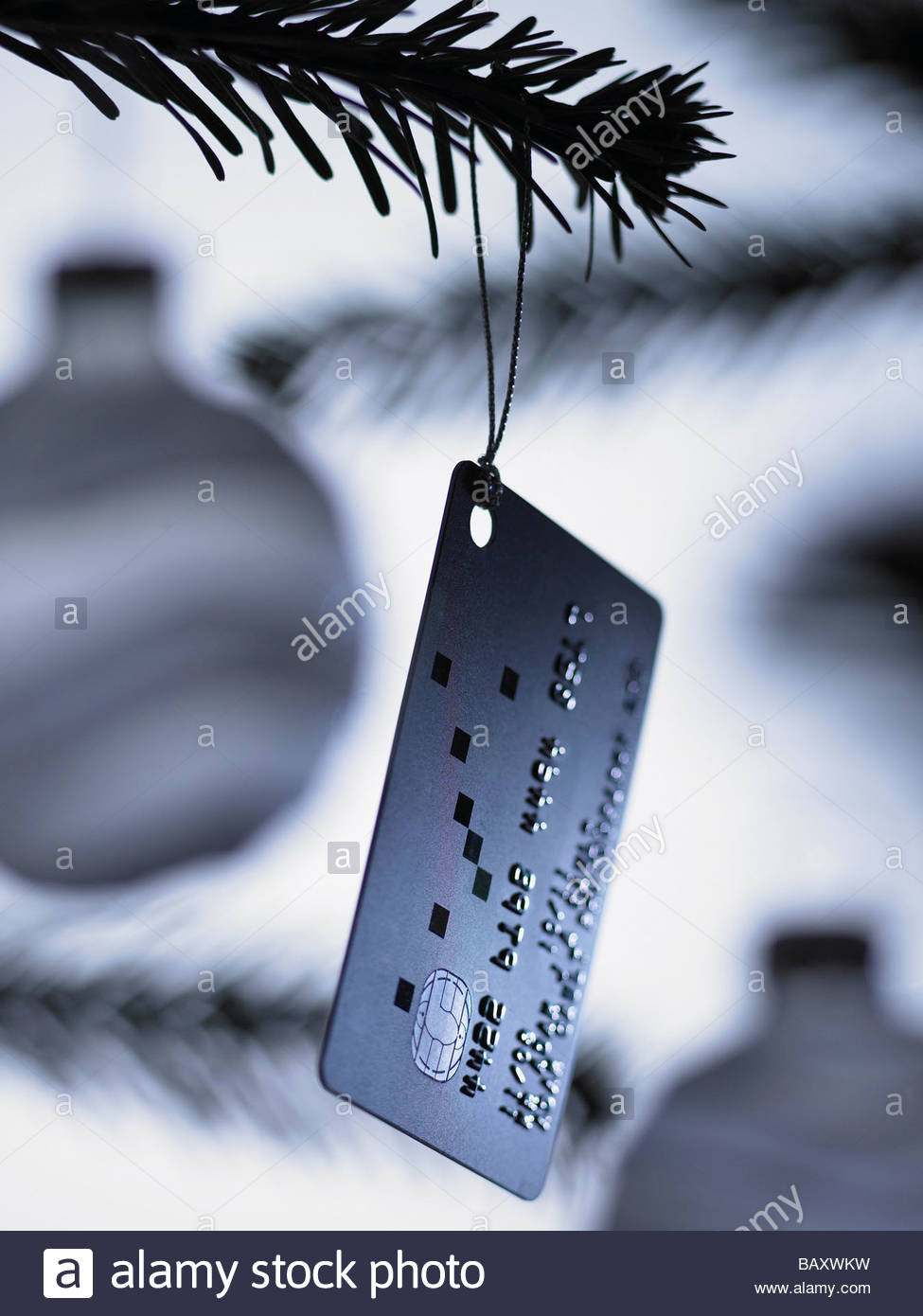 Close up of credit card Christmas ornament on tree - Stock Image