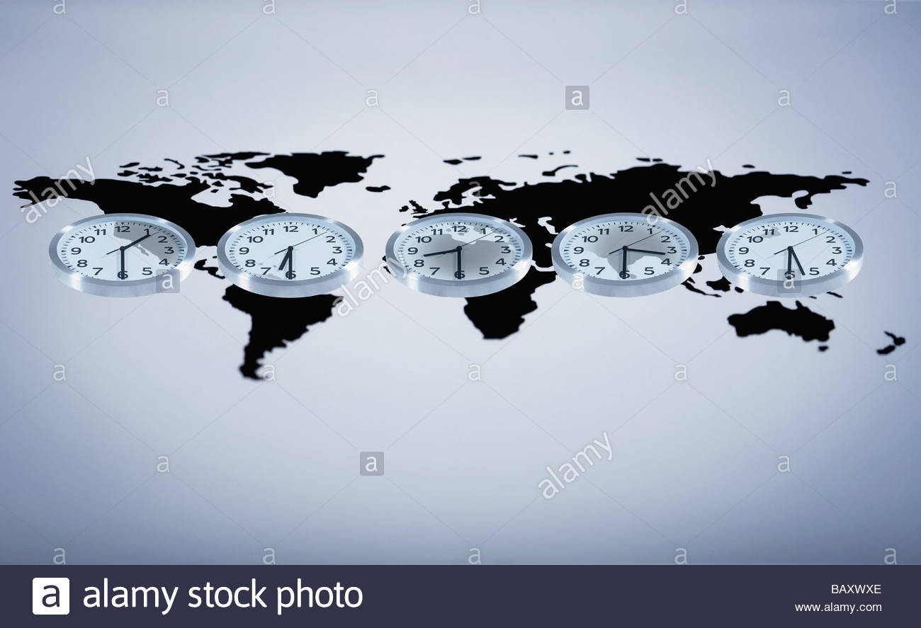 Time zone clocks on world map - Stock Image