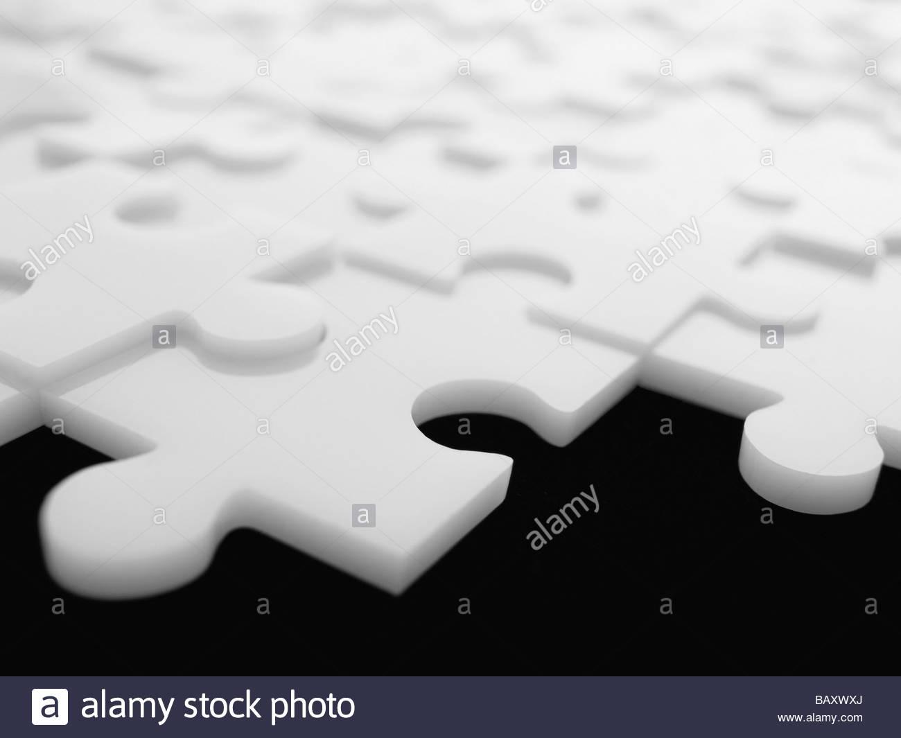 Interlocking puzzle pieces - Stock Image