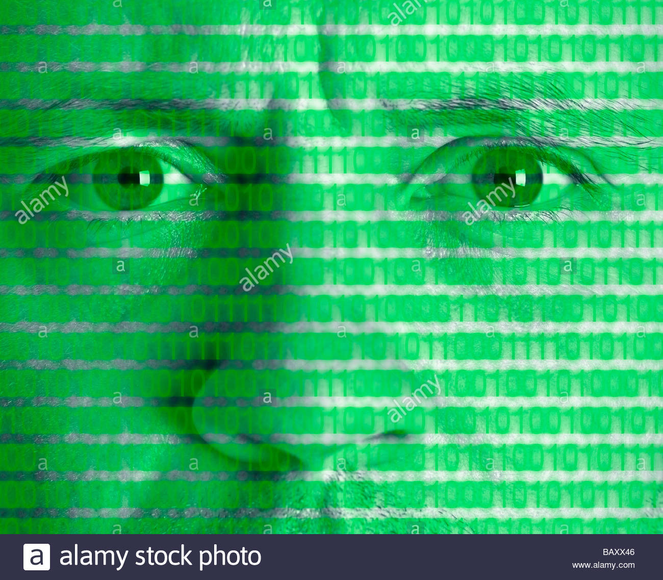 Montage of man's face with binary code - Stock Image