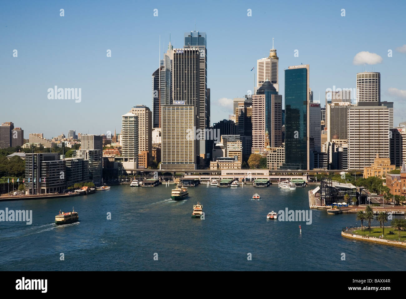 Boat traffic in busy Circular Quay the ferry terminus and rail stop with the high rises of the CBD beyond in Sydney - Stock Image