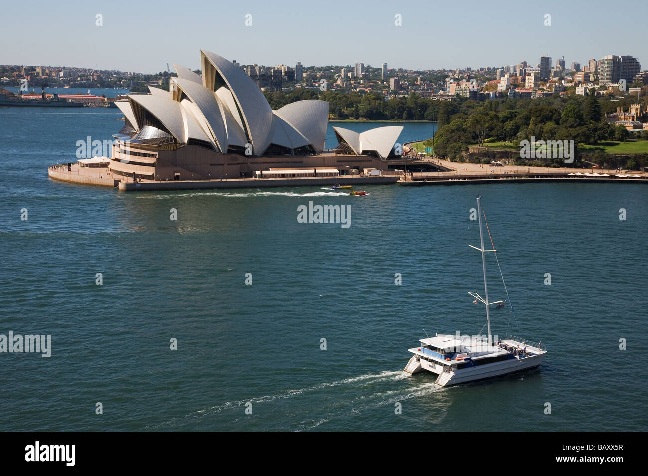 The Opera House designed by Jorn Utzon and built 1973 with tour boat arriving at Circular Quay Sydney New South - Stock Image