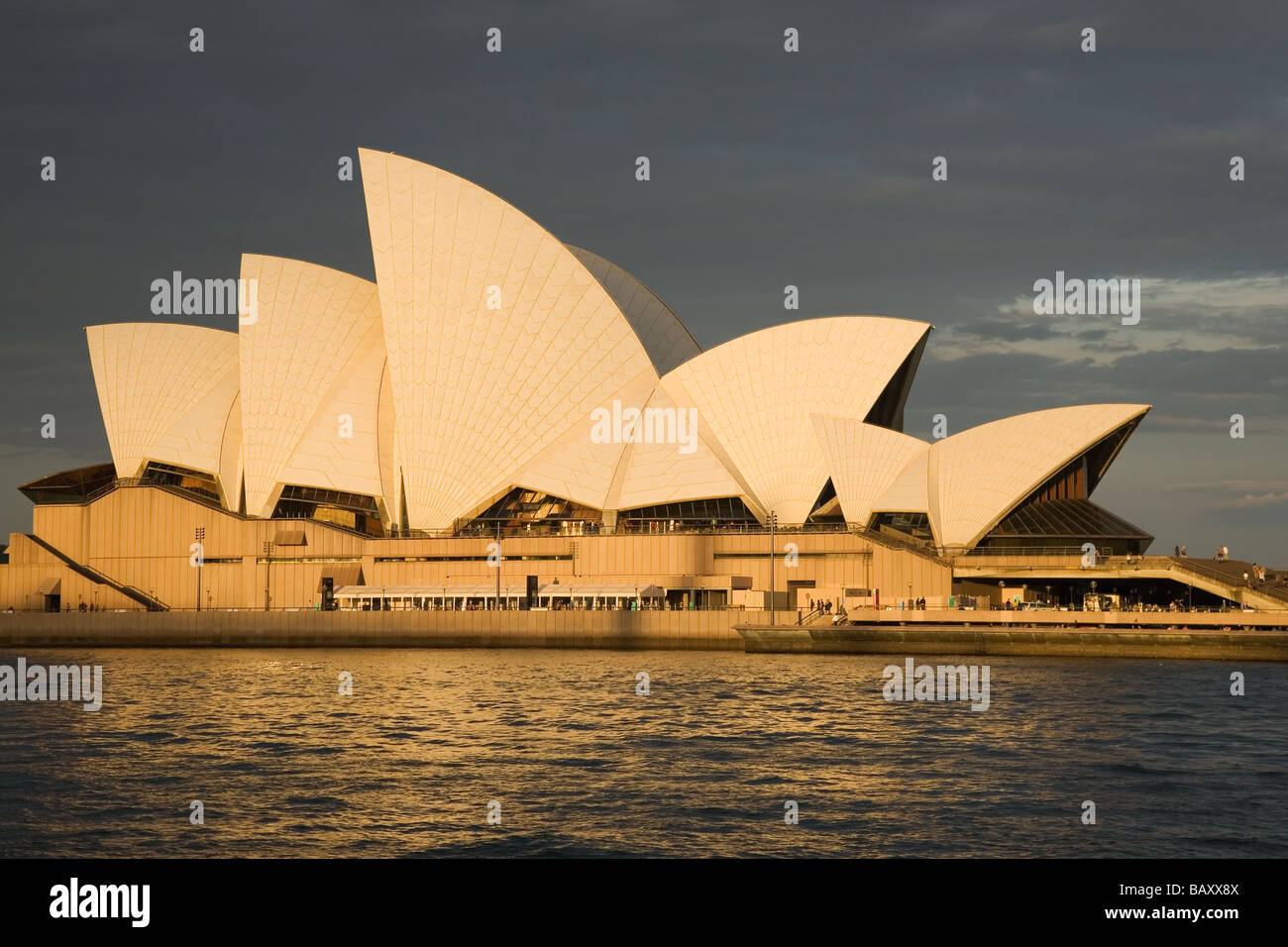 The Opera House designed by Jorn Utzon and built 1973 by Circular Quay at sunset Sydney New South Wales Australia - Stock Image