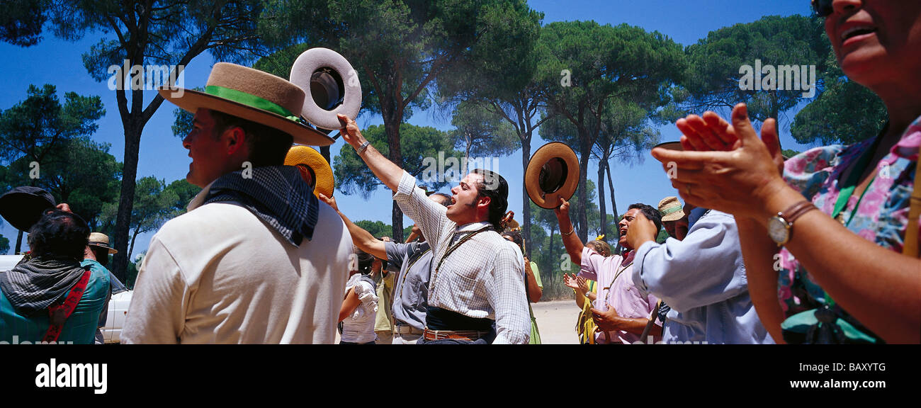 Pilgrims clapping hands and saluting on the Raya Real, Andalusia, Spain - Stock Image