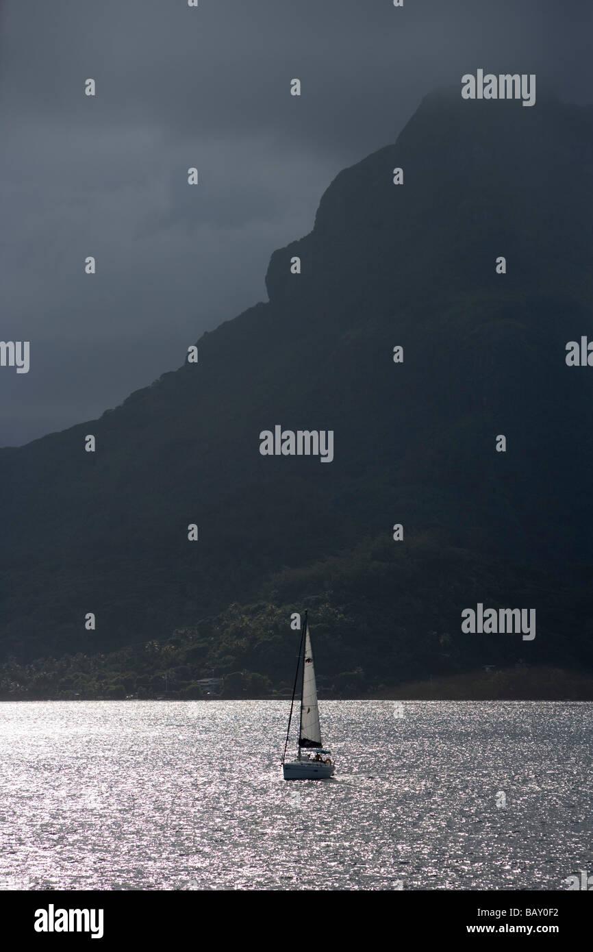 Moorings Charter Yacht Sailboat and Mount Otemanu in Bora Bora Lagoon, Bora Bora, Society Islands, French Polynesia - Stock Image