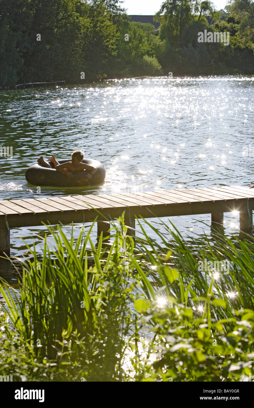Boy bathing at Wesslinger Lake on a summer's day, Bavaria, Germany - Stock Image