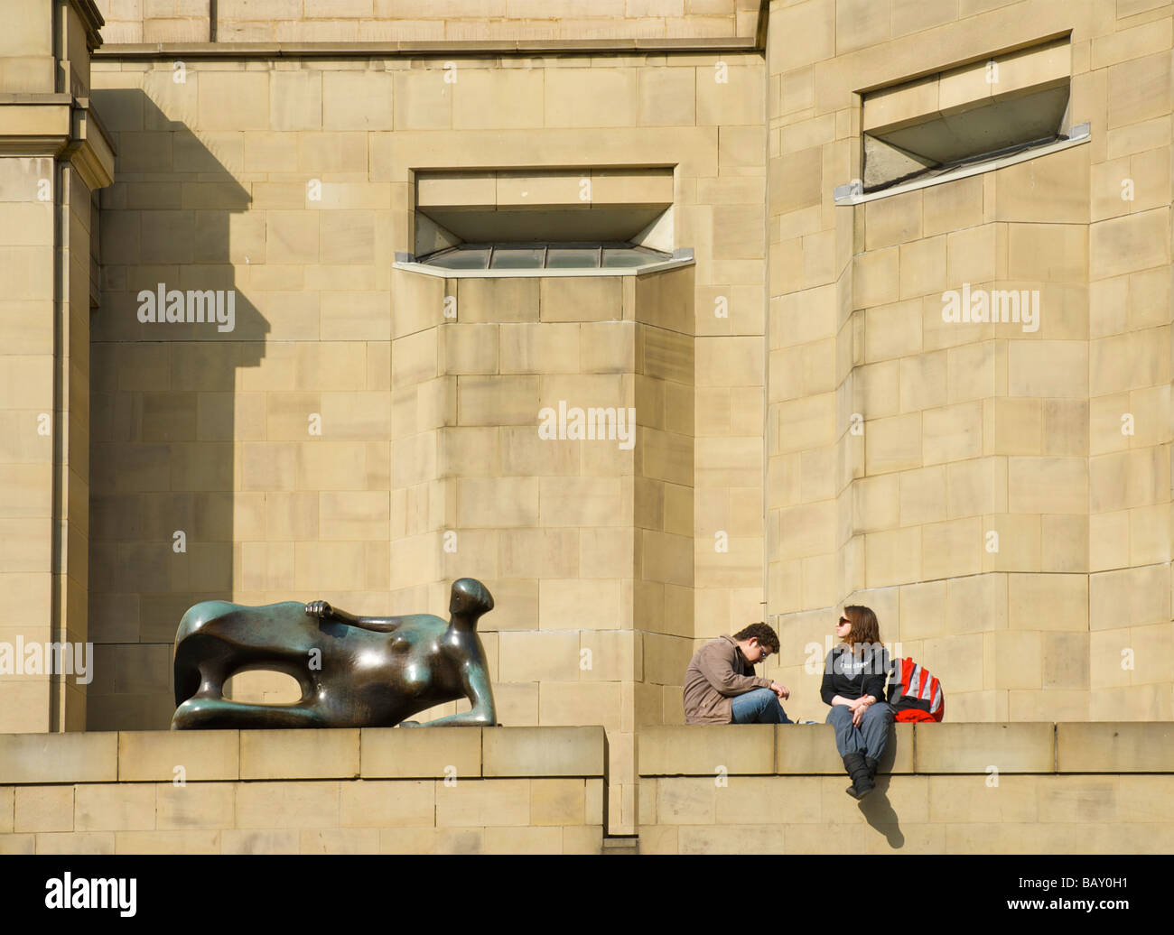 People relaxing outside Leeds Art Gallery, next to Henry Moore\'s ...