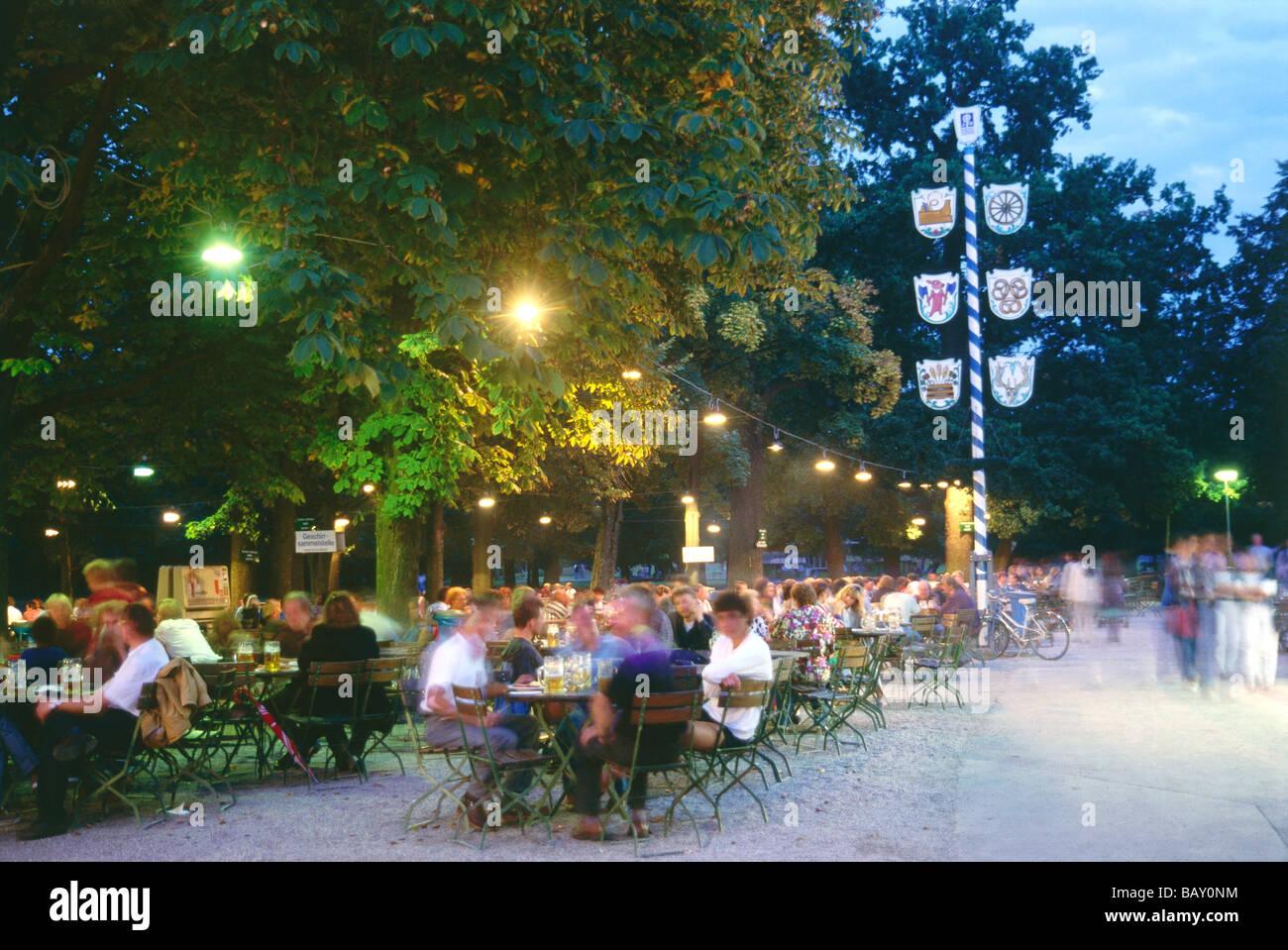 Fully occupied beer garden at Hirschgarten, Munich, Bavaria, Germany - Stock Image