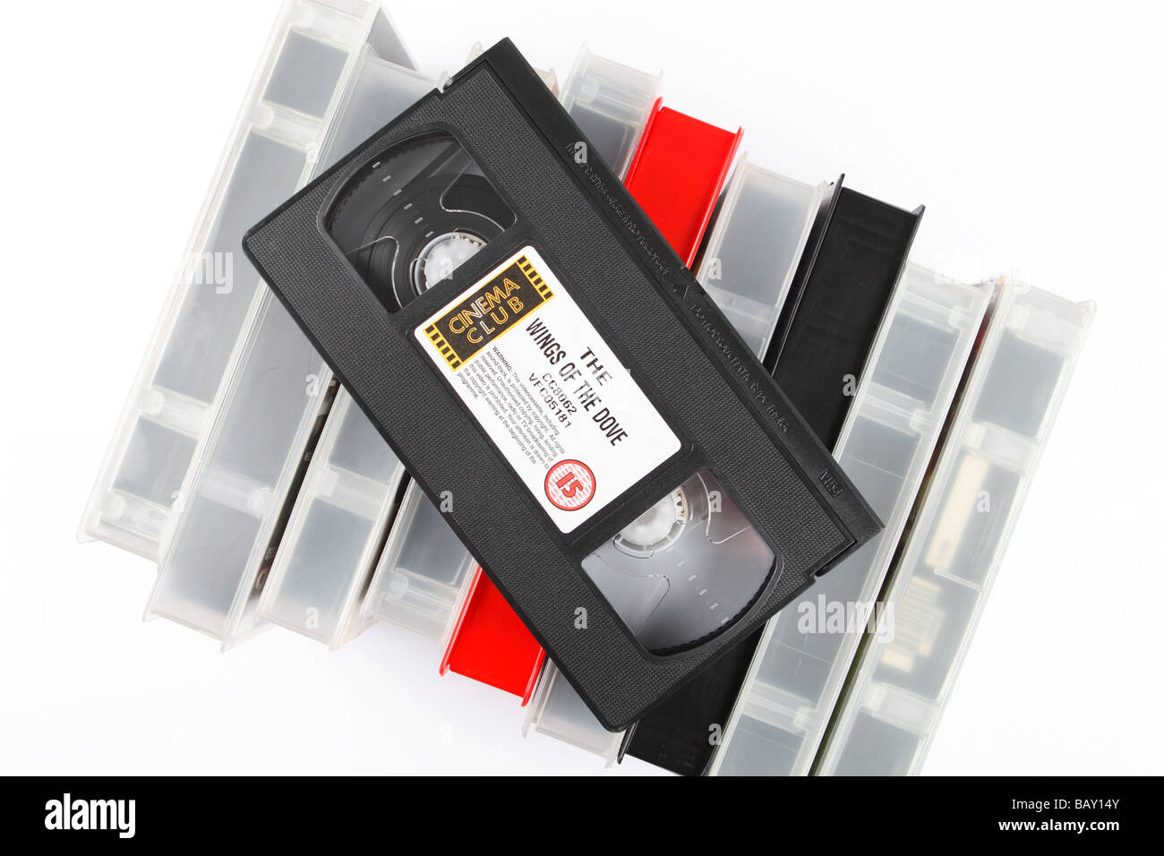 VCR pre recorded film movie video cassette tapes pile stack of videos - Stock Image