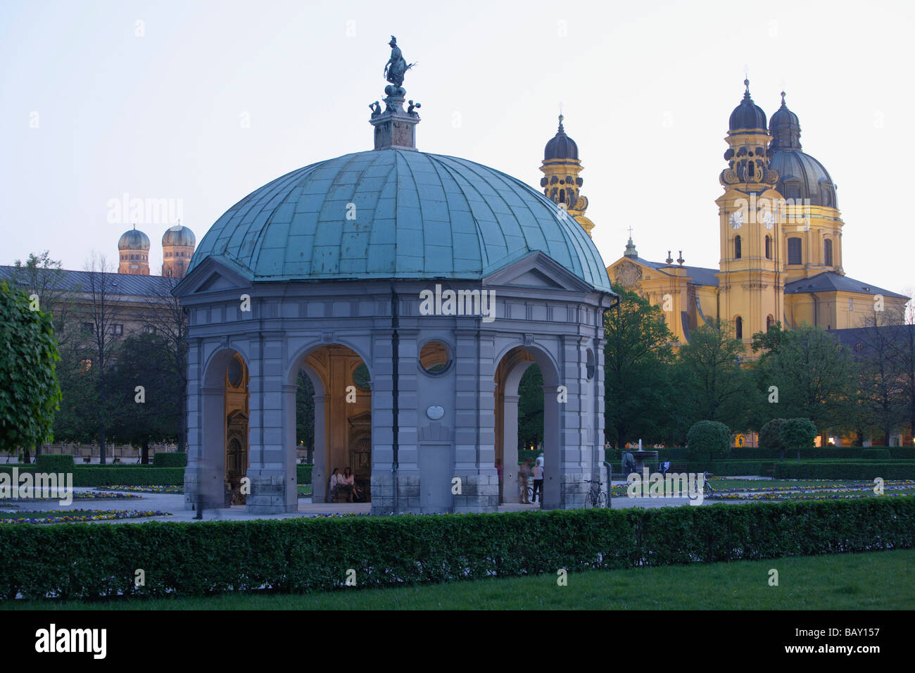 Pavillion at Hofgarten, the onionshaped towers of Frauenkirche and Theatinerkirche in the background, Munich, Bavaria, - Stock Image