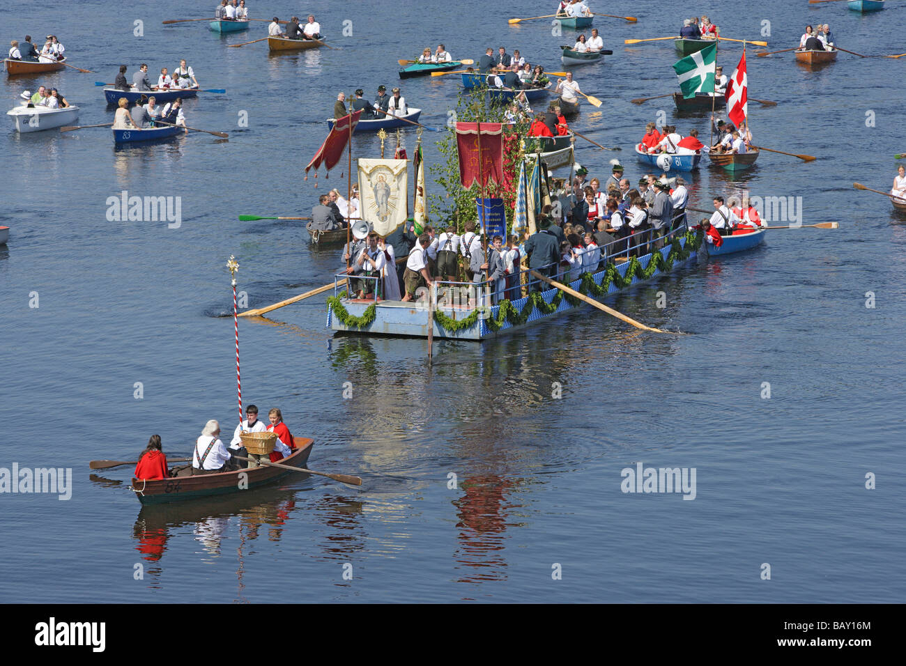 People in rowing boats, Boat procession at Corpus Christi at lake Staffelsee, Bavaria, Germany - Stock Image