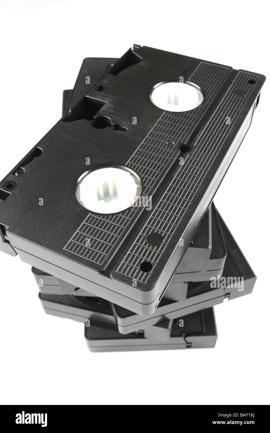 VCR video cassette tapes pile stack of videos - Stock Image