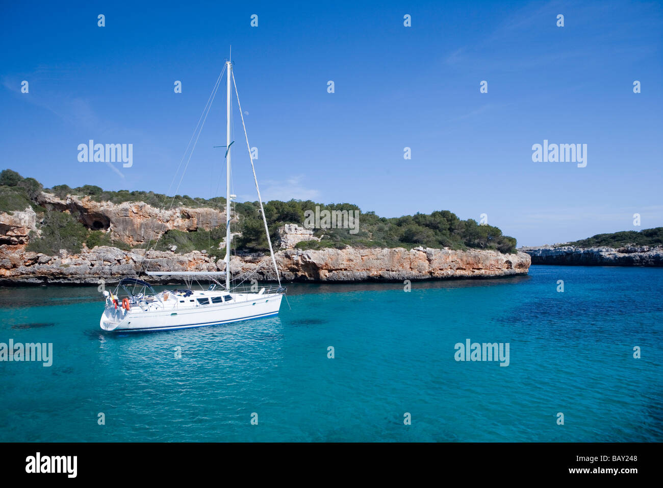 Sailboat at Cala sa Nau Cove, Cala sa Nau, Mallorca, Balearic Islands, Spain - Stock Image