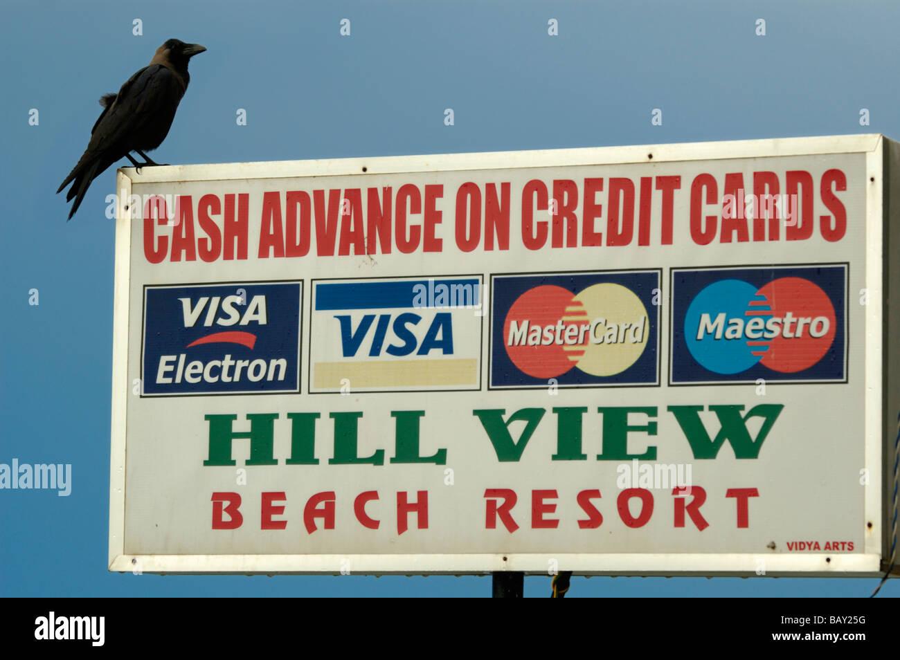 India, Kerala, Varkala Beach. Sign reading cash advance in Varkala Beach. - Stock Image