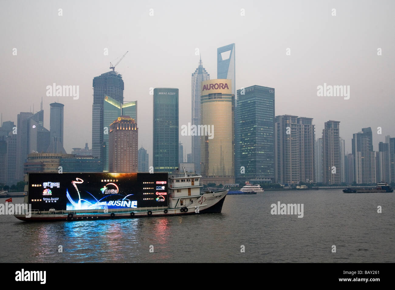 A Mobile Advertising Billboard Floats Down The Huangpu River