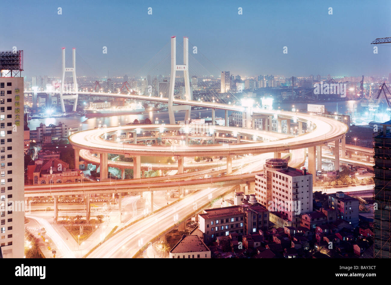 Trails of blurred light on the Nanpu Bridge, View of the city, Shanghai, China Stock Photo