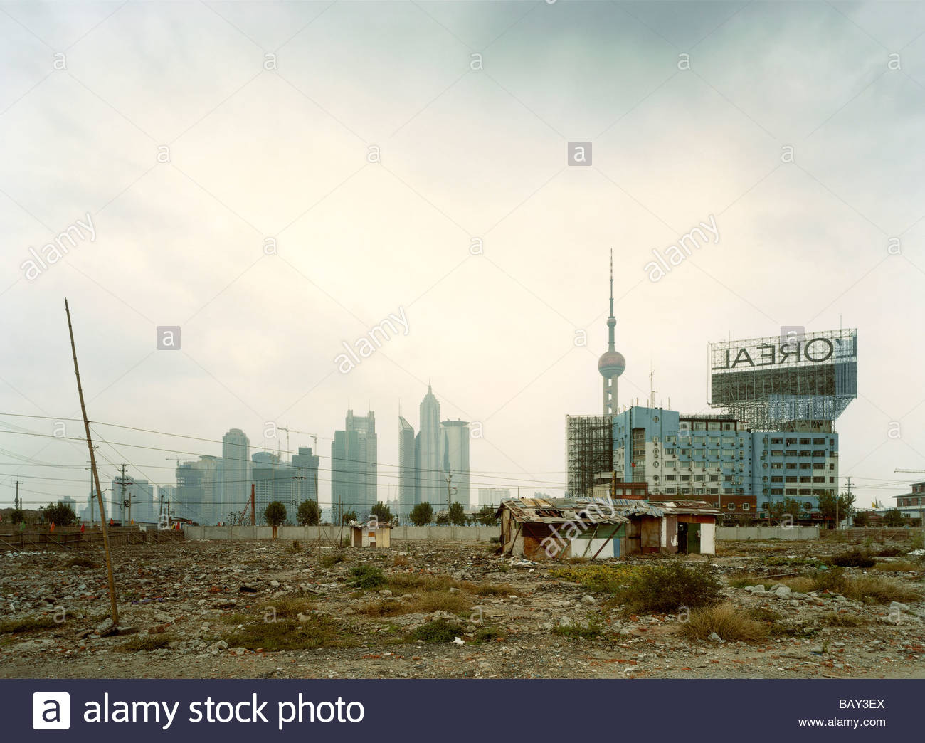 Area is being demolished to make way for new skyscraper buildings, Construction wasteland, Pudong Skyline in the - Stock Image